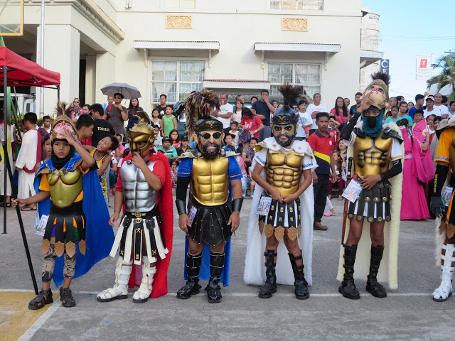 child wearing moriones costumes
